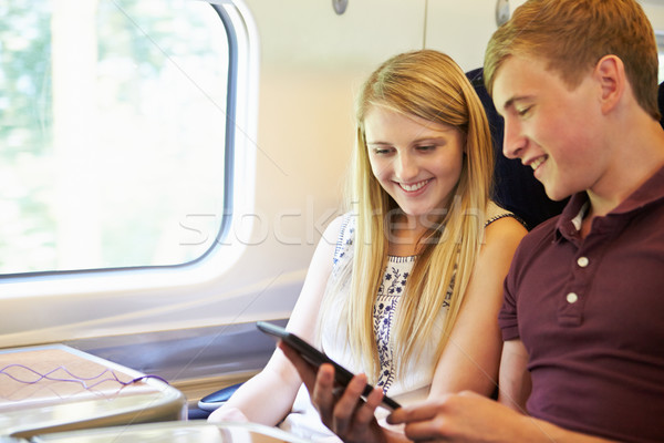 Leitura livro trem jornada homem Foto stock © monkey_business