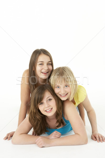 Stock photo: Group Of Three Young Girls In Studio