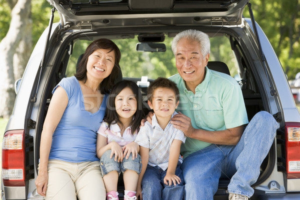 Grandparents with grandkids in tailgate of car Stock photo © monkey_business