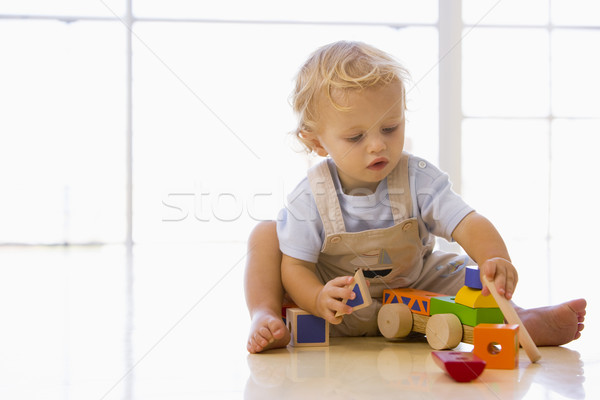Baby indoors playing with toy truck Stock photo © monkey_business