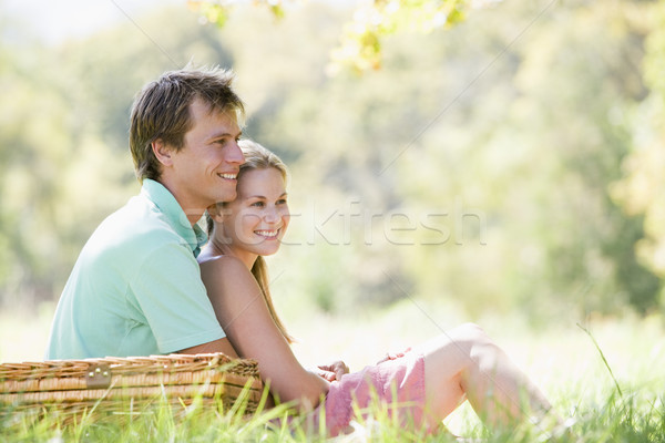 Casal parque piquenique sorridente grama homem Foto stock © monkey_business