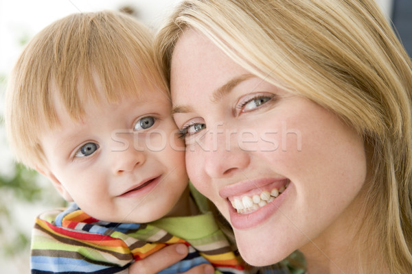 Mother and young boy indoors smiling Stock photo © monkey_business