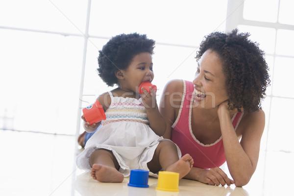 Anya lánygyermek bent játszik mosolyog baba Stock fotó © monkey_business
