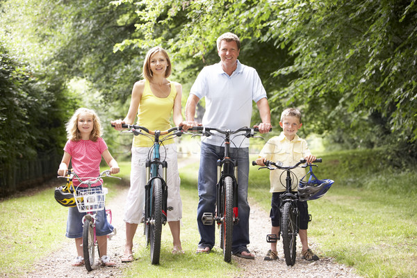 Family riding bikes in countryside Stock photo © monkey_business