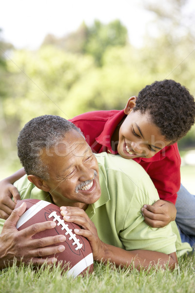 Grandfather With Grandson In Park With American Football Stock photo © monkey_business