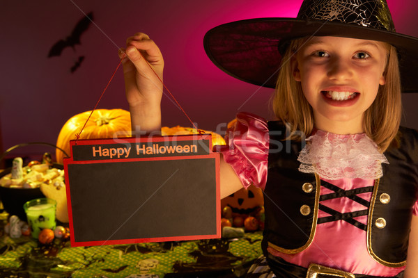 Halloween party with a child holding sign in hand Stock photo © monkey_business