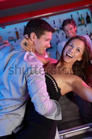 Senior Man Dancing With Younger Woman In Busy Bar Stock photo © monkey_business