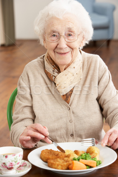 Stock photo: Senior Woman Enjoying Meal