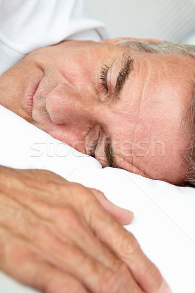 Stock photo: Head and shoulders mid age man sleeping
