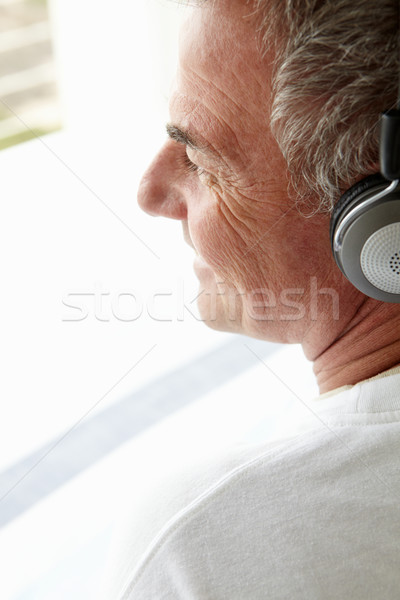 Mid age man wearing headphones Stock photo © monkey_business