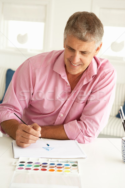 Mid age man painting with watercolors Stock photo © monkey_business