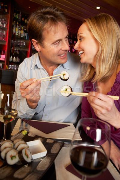 Couple Enjoying Sushi In Restaurant Stock photo © monkey_business