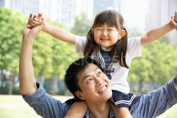 Chinese Father Giving Daughter Ride On Shoulders In Park Stock photo © monkey_business