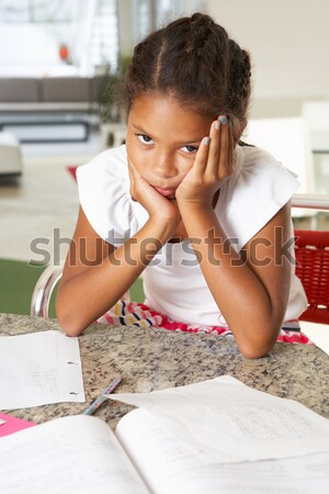 Fed Up Girl Doing Homework In Kitchen Stock photo © monkey_business