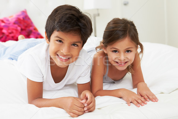 Children Lying On Bed In Pajamas Together Stock photo © monkey_business