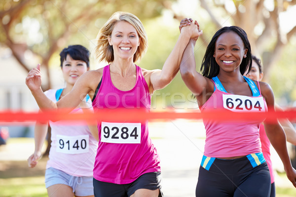 Two Female Runners Finishing Race Together Stock photo © monkey_business