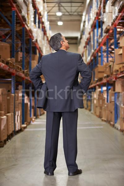 Сток-фото: вид · сзади · менеджера · склад · человека · бизнесмен · окна