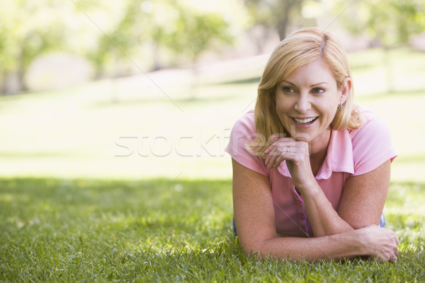Woman relaxing outdoors smiling Stock photo © monkey_business