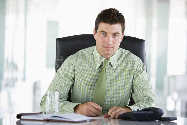 Businessman sitting in office with personal organizer Stock photo © monkey_business