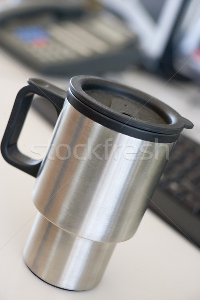 Shot of a reusable coffee cup on a desk Stock photo © monkey_business