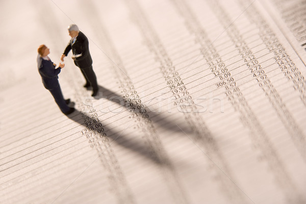 Figurines Of Two Businessmen Shaking Hands On A Financial Newspa Stock photo © monkey_business