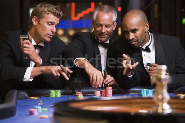 Group of men gambling at roulette table Stock photo © monkey_business