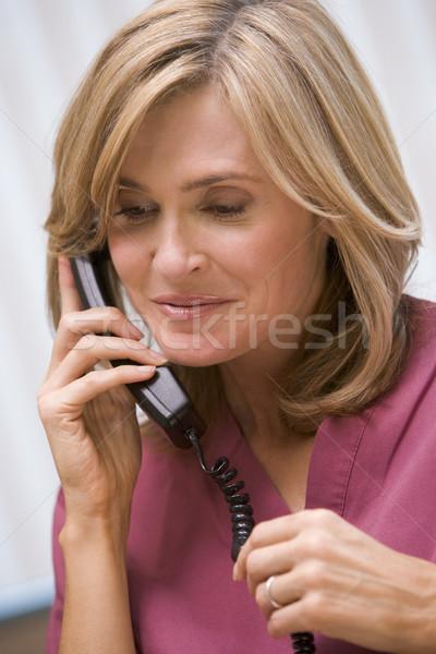 Consulente client una buona notizia chirurgia donna colore Foto d'archivio © monkey_business