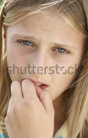 Portrait Of Girl Biting Nails Stock photo © monkey_business