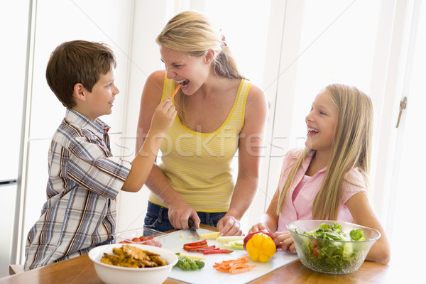 Mother And Children Prepare A meal,mealtime Together  Stock photo © monkey_business