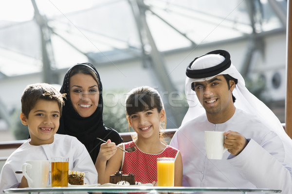 A Middle Eastern family enjoying a meal in a restaurant Stock photo © monkey_business