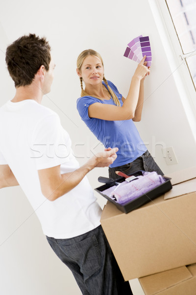 Pareja pintura nuevo hogar sonriendo casa hombre Foto stock © monkey_business