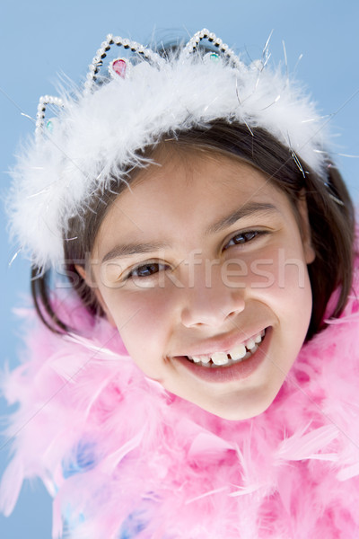 Young girl wearing crown and feather boa smiling Stock photo © monkey_business