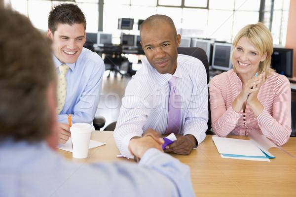 Stock intervista donna ufficio uomini finanziare Foto d'archivio © monkey_business