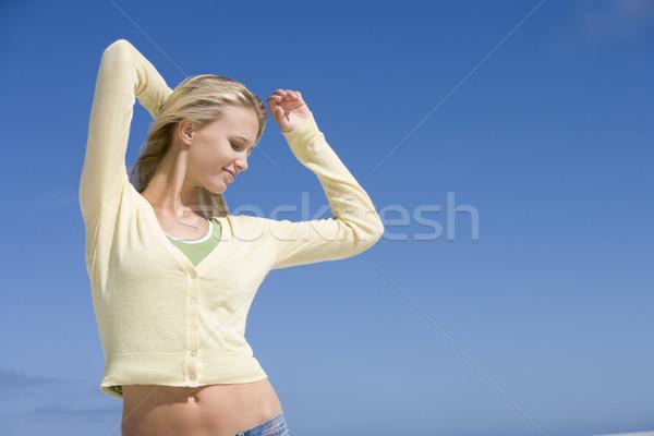 расслабляющая пляж Blue Sky женщину счастливым Сток-фото © monkey_business