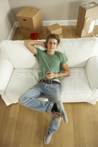 Stock photo: Young Man Moving Into New Home