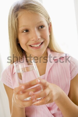 Young Woman Not Enjoying Healthy Drink In Studio Stock photo © monkey_business