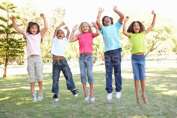 Group Of Children Jumping In Air In Park Stock photo © monkey_business