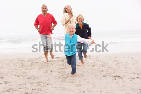 Stock photo: Young Family Running Along Winter Beach