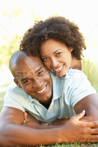 Portrait Of Young Couple Laying On Grass In Park Stock photo © monkey_business
