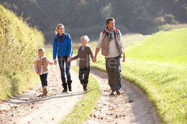 Young family walking in park Stock photo © monkey_business