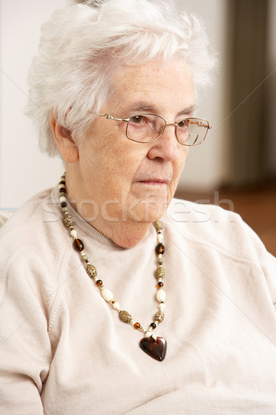Senior Woman Looking Sad In Chair At Home Stock photo © monkey_business
