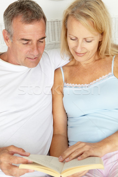 Mid age couple reading together Stock photo © monkey_business