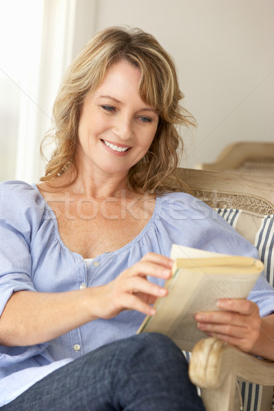 Mid age woman reading a book Stock photo © monkey_business