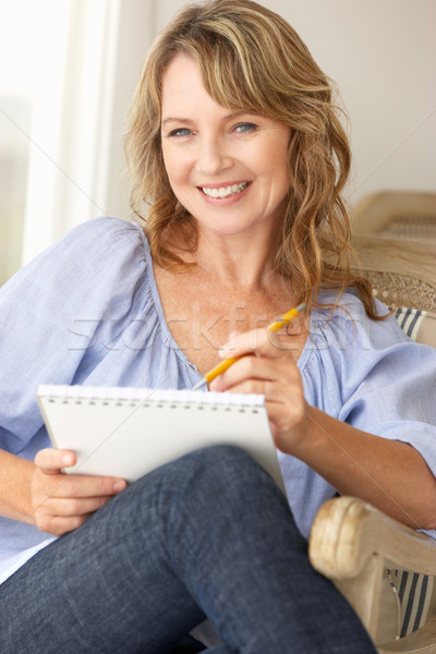 Mid age woman sketching Stock photo © monkey_business