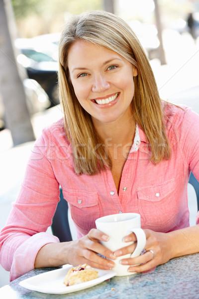 Woman sitting at sidewalk caf Stock photo © monkey_business