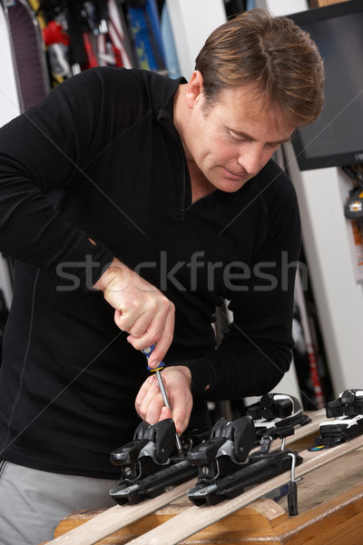 Sales Assistant Adjusting Fittings On Skis In Hire Shop Stock photo © monkey_business
