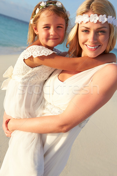 Bride With Bridesmaid At Beautiful Beach Wedding Stock photo © monkey_business