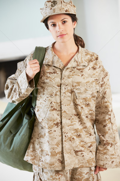 Female Soldier With Kit Bag Home For Leave Stock photo © monkey_business