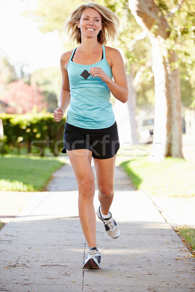 Female Runner Exercising On Suburban Street Stock photo © monkey_business