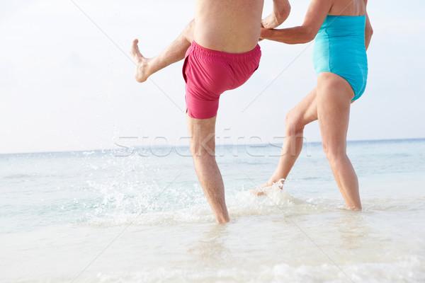 Detail Of Senior Couple Splashing In Sea On Beach Holiday Stock photo © monkey_business